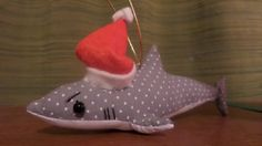 A grumpy polka dot shark to hang from a Christmas tree.