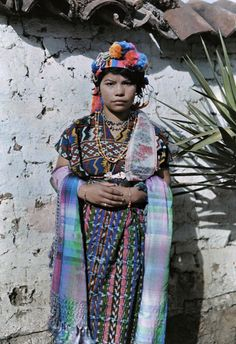 Central America | Portrait of a Mayan woman wearing traditional clothes and headdress, Guatemala #maya #pompom