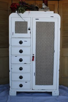 Vintage White Clothing Armoire with two locking doors complete with skeleton keys!  Love it.