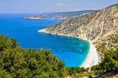 Kefalonia Myrtos, Greece Recognized for its natural splendor, pristine Myrtos beach is surrounded by cliffs and vegetation that make for an idyllic seaside day—and photo op. 6 Beaches with Crystal-Clear Water Photos Myrtos Beach, Crystal Clear Water, Turquoise Water, Beach Resorts, Beach Vacations, Greek Islands, Historical Sites, Landscape Photography, Travel Photography