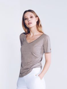 Our new v for versatile shirt in the color nomad. This classic shirt is made from a blend of tencel and merino wool. Designer Sportswear, Hip Bones, Zurich, Happy Sunday, Merino Wool, Editorial Fashion, Tights, Feminine, Chic