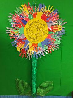 'Friendship flower' display using children's handprints in Eyfs reception classroom :)