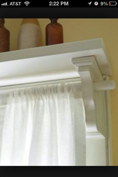 Shelf above curtain rod