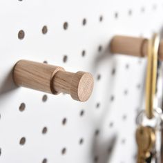 A large wooden pegboard peg for hanging heavier and larger items. Will fit any Block pegboard, and is provided with a screw for extra strength.