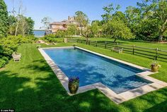 A 60-foot heated pool surrounded by a pristine lawn the ultimate spot for relaxation.