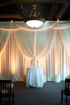 a simple ceremony setup can be enhance by beautiful draping and dramatic lighting.  chicago wedding at fultons on the river from jennifer jackson photography  Read more - http://www.stylemepretty.com/illinois-weddings/2013/11/01/chicago-wedding-at-fultons-on-the-river-from-jennifer-jackson-photography/