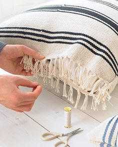 pillow cases made from ikea rugs. so awesome.Step 1 - For a Large Pillow - Stack and pin together 2 throw rugs. Making 1/4-inch stitches, sew 3 sides by hand, leaving 1 short end open. Turn inside out (the fringe on sewn end will remain inside). Insert 2 bed pillows. Stitch end closed.