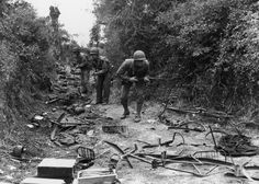 American troops advancing through a wood near Valognes, on the Cherbourg front. The track is littered with parts of bicyles and ironmongery June 27, 1944. (Fred Ramage, Keystone / Getty Images)