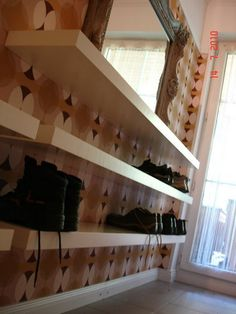 floating shelves for shoes in walk in closet