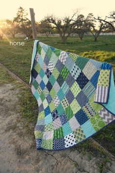 Green and Blue Patchwork Quilt and a photobomber