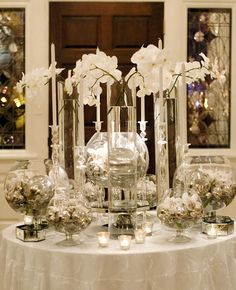 pics of icy/snowy party tablescapes   ... white party.. I like the orchids, the candles, the silver and white