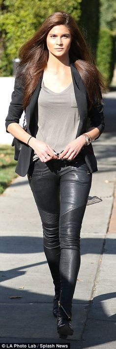 Lovely in leather: Sandberg showed off her svelte physique in skintight black leather pant...