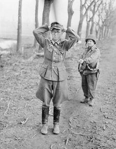 A young German officer captured by troops of the 102nd Infantry Division , Ninth US Army near Gevenich, Germany, February 1945.