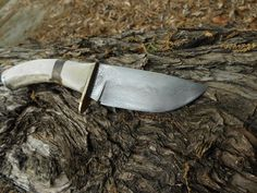 Hand forged 200 layer skinner, bronze guard and stag handle.