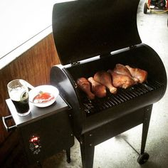 Low-n-slow smoked turkey legs on the Traeger. They were brined in kosher salt, bay leaves, whole peppercorns, and garlic. The Guinness next to my mopping concoction is there to make my friends who are at work a wee bit jealous  #traeger #smokedturkeyleg