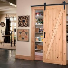 Masonite 42 in. x 84 in. Z-Bar Knotty Alder Interior Barn Door Slab with Sliding Door Hardware Kit 47613 at The Home Depot - Mobile - June 13 2019 at Sliding Door Design, Interior Sliding Barn Doors, Sliding Barn Door Hardware, Hanging Sliding Doors, Wooden Pantry, Barn Door Designs, Wooden Doors, Pine Doors, House Design