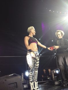 Here she is handing the shirt to him.
