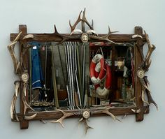 carved wood wall mirror decorated with antlers and horn roses