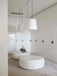White. Ottomans. Lacquer joinery.