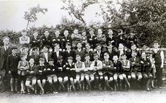Killaloe Boys National School.  Students of Killaloe Boys National School c. 1955. BACK ROW: (L-R): Oliver Lynch, Christy Geraghty, Sean Kissane, Aiden McDonagh, Charles O'Connor, John Cahill, Fergus Scanlan, John Aherne, John Malone, Tom Collins, Anthony Aherne, Tommy McMahon. MIDDLE ROW: (L-R): Michael J. Lynch [N.T.], Gussie Hinchey, David Geraghty, John Halpin, Bill Blake, Syl Addley, Andy McDonagh, Tom Keane, Michael Connolly, Pat Mulcahy, Mike Kelly, Sean Grimes, Ignatius McDonagh, ...