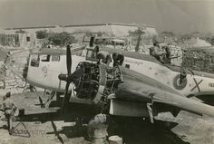 Malta at war: Engineers work on the engine of an RAF Martin Baltimore reconnaissance aircraft based at RAF Luqa in 1943