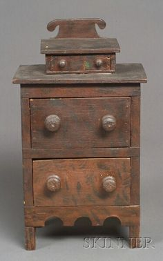 Miniature Grain-painted Basswood Chest of Drawers, probably Vermont, 1835-45. ht. 12, wd. 6 1/4, dp. 3 7/8 in.