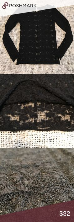 """Free People black lace top size M Beautiful black lace top long sleeve size M. Has a line going down the top of each arm as shown in the fourth photo. Completely sheer. Good used condition. Has a """"feathery"""" detail all over, hard to get a photo of it you can somewhat tell in the second photo. Has a shimmery look to it too. Free People Tops"""