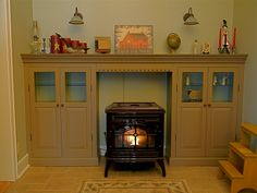 wood stove mantel:  pellet stove surround the cabinets are on castors to allow easy maintenance for the stove.
