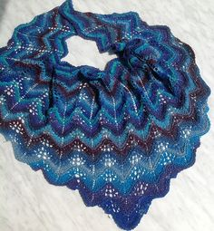 worsted weight.  Ravelry: Blossoms by the Brook pattern by Ilga Leja