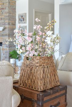 A gorgeous basket full of flowers for a spring! A simple refresh in the living room with great items from Marshalls!   #MarshallsSurprise #Ad