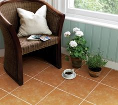 Terracotta floor with blue wall