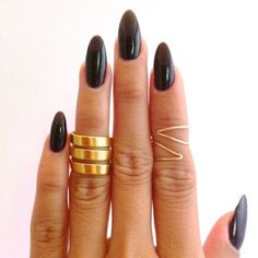 Black, high gloss on a pointed nail. Really adore this length/shape.