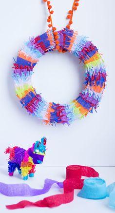 Make this piñata inspired fiesta wreath for your cinco de mayo party