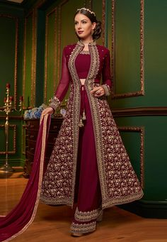 Navy blue designer jacket style suit online which is crafted from georgette fabric with exclusive zari embroidery and stone work. This stunning embroidered jacket style suit comes with santoon bottom and chiffon dupatta. Eid Dresses, Pakistani Dresses, Indian Dresses, Indian Outfits, Fashion Dresses, Designer Salwar Suits, Designer Anarkali, Designer Dresses, Designer Jackets