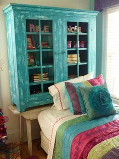 Use an old bookshelf or cabinet stacked on a table or high bench to create a unique DIY headboard