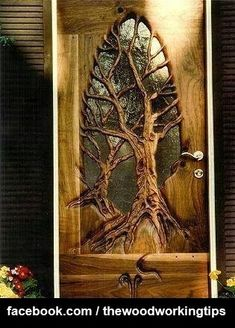 This unique door has two trees hand carved into the wood- certainly a work of ar. Holzschnitzen , This unique door has two trees hand carved into the wood- certainly a work of ar. This unique door has two trees hand carved into the wood- certainl. Cool Doors, The Doors, Unique Doors, Windows And Doors, Wood Working For Beginners, Door Knockers, Door Knob, Doorway, Wood Art