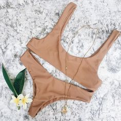 Dara Top x Kaliyan Bottoms in MOCHA | Minimal and flattering - the comfiest bikini to wear when you're out playing on your next adventure! Get the look at www.sereiclothing.com