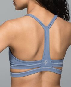 """We designed this super-soft, low-coverage bra for sunny classes and evening dance parties. Glow-in-the-dark thread is woven into the seams and """"charges"""" up in the sun—basking in our post-practice glow just gained new meaning."""