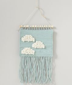 This ethnic-inspired and poetic woven wall hanging is a must-have piece for any child's bedroom. Crochet Wall Hangings, Weaving Wall Hanging, Tapestry Crochet, Weaving Art, Loom Weaving, Tapestry Weaving, Wall Tapestry, Weaving Projects, Crochet Projects