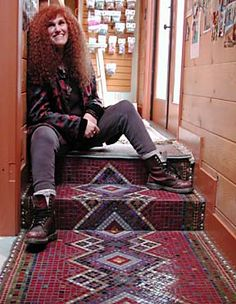 [Laurel Skye sitting in hallway of tiles]