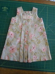 Oh so cute! Other views and link to pattern. I might really have to try my hand at sewing again...