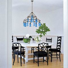 Sarah Jessica Parker Hamptons dining room.  I love mismatched chairs painted the same color.