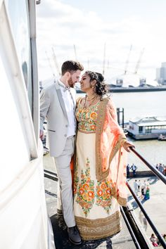 Trinity Bouy Wharf London wedding with a Hindu ceremony, tropical wedding flowers and a boat trip down the Thames captured by Lydia Stamps Photography. London Skyline, London Wedding, Lighthouse, Backdrops, Wedding Flowers, Stamps, Vibrant, Photography, Fashion