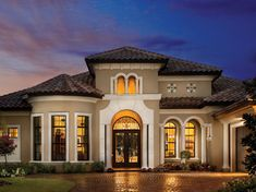 Mediterranean exterior by Arthur Rutenberg Homes. Mediterranean architecture looks great in warm colors that lean toward neutral, like sandy golds and terra-cotta colors look great for this style of home. Here the paint is Colonial Revival Stone SW 2827 by Sherwin-Williams.