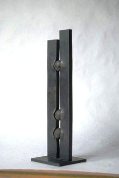 Geometric metal sculpture. Metal art. Interior metal
