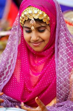 Shy smile from Oman.