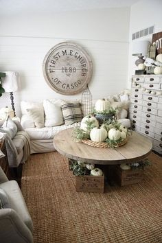 Let white pumpkins take center stage in your living roomfor a cozy, farmhouse-style autumn display. Gussy up your coffee table with the miniature pumpkins.