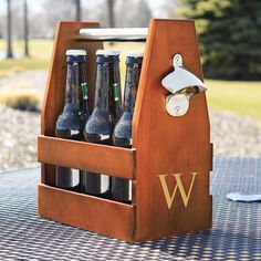 Pick out six bottles of craft beer for your best guys and give to each of your groomsmen in this wooden carrier. It comes with a built in bottle opener - making this possibly the best gift ever.