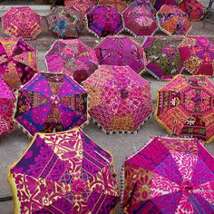 Indian umbrellas, inspired by the 'Spirit-of-the-Holi-Colors,' with very colorful designs-patterns may just be unique to India.