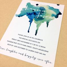 Paint Splatter: This modern engagement party invitation with a watercolor splatter of blues and greens is unique and attention-grabbing. We think this is a fitting invite for a more urban event, perhaps one at a downtown cafe or art gallery.